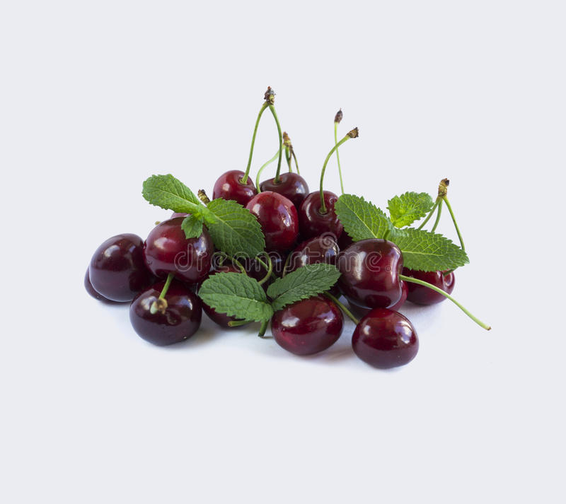 Sweet cherry berries with mint isolated on white background royalty free stock photography