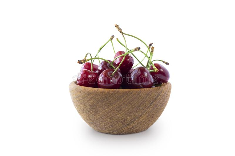 Sweet cherry berries in wooden bowl isolated on white background stock images