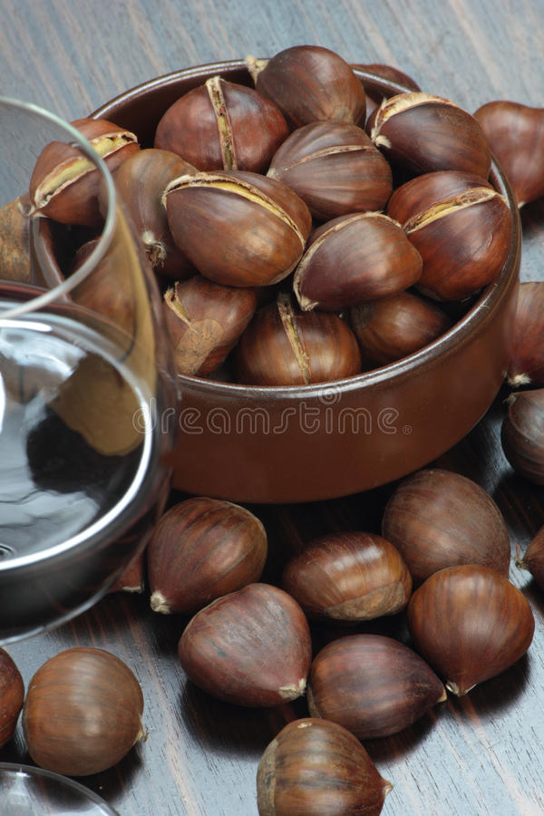 Sweet chestnuts and red wine. royalty free stock images