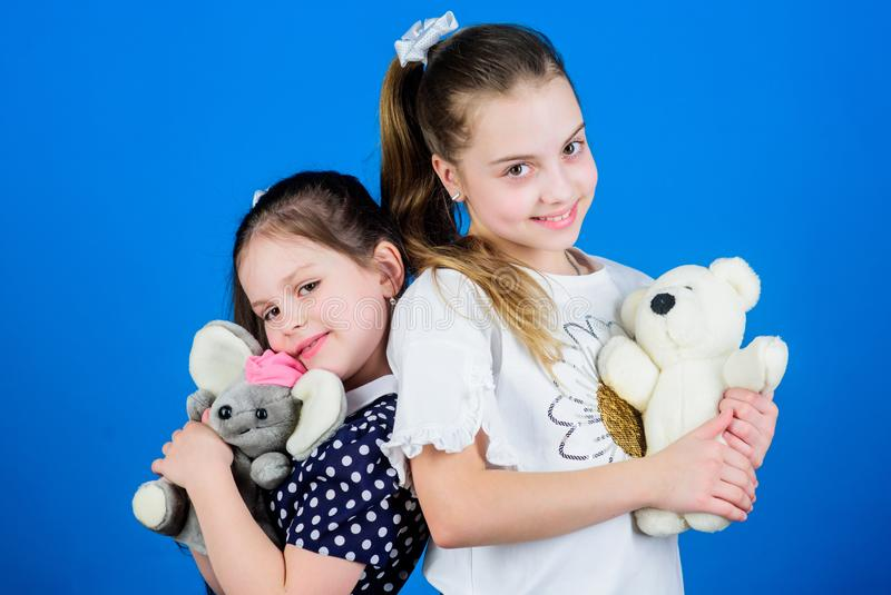 Sweet childhood. Childhood concept. Kids adorable cute girls play with soft toys. Happy childhood. Child care. Excellence in early childhood education. Sisters stock images