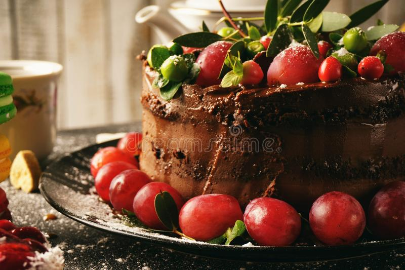 Sweet chocolate cake with grapes royalty free stock photography