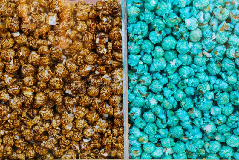 Chocolate caramel popcorns in the glass box royalty free stock images