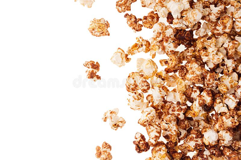 Sweet chocolate popcorn as decorative border with copy space, isolated. Fast food background, top view. Sweet chocolate popcorn as decorative border with copy royalty free stock photos