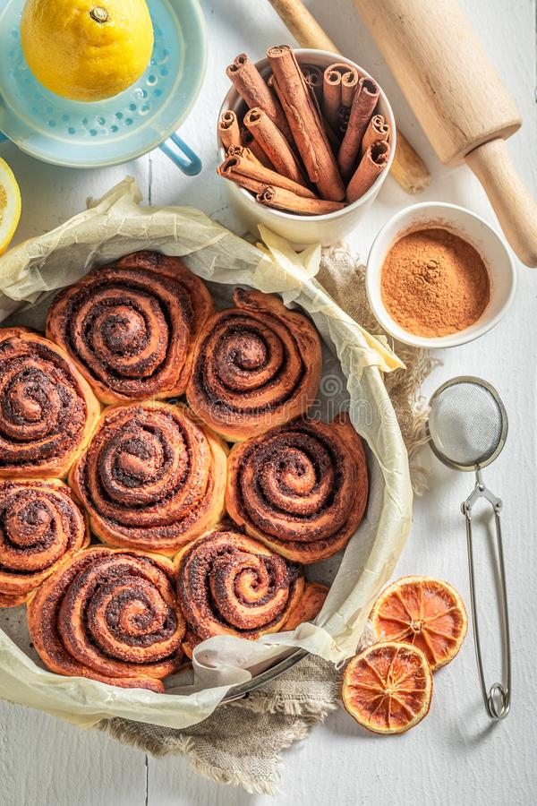 Sweet cinnamon buns as swedish christmas dessert. On white table royalty free stock photo
