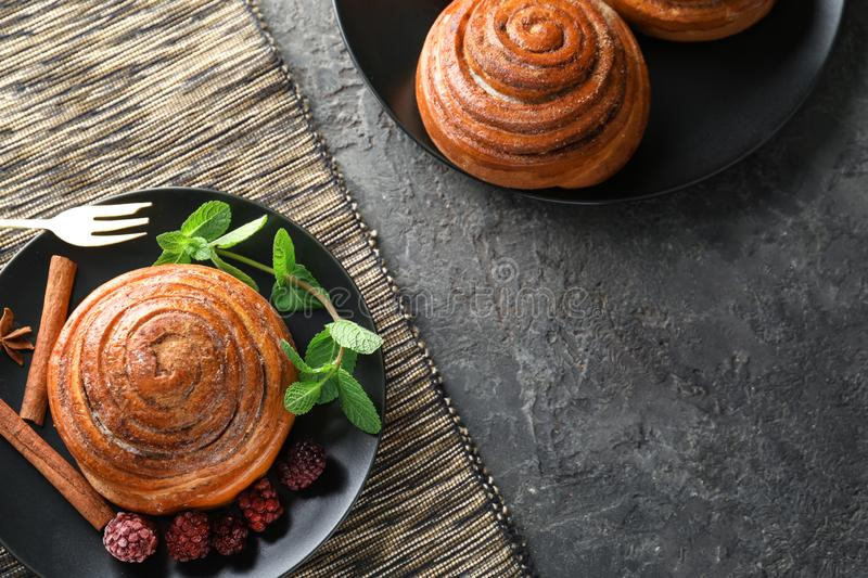 Sweet cinnamon buns and berries on table royalty free stock photos