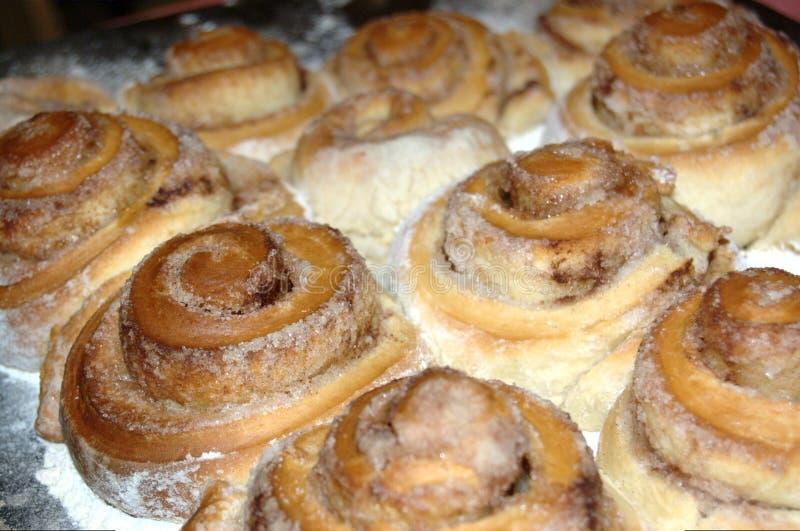 Sweet cinnamon rolls from yeast dough stock photos
