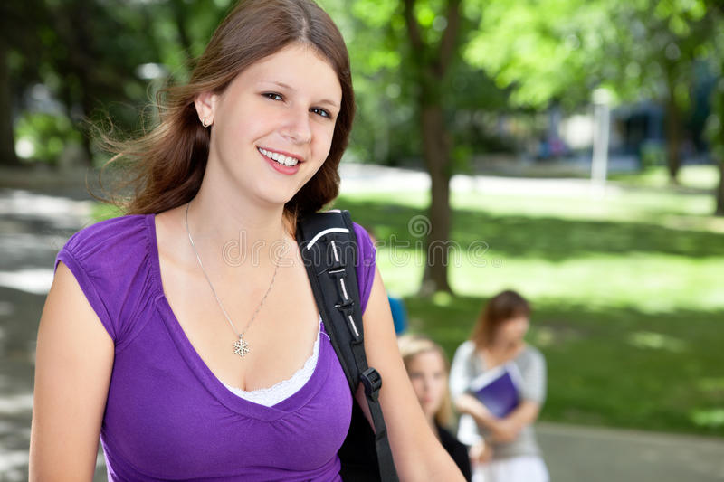 Sweet college girl smiling royalty free stock photos