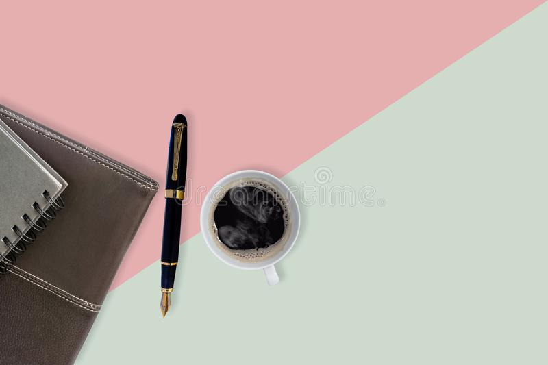 Sweet color office table with fountain pen , notebook and cup off coffee stock images