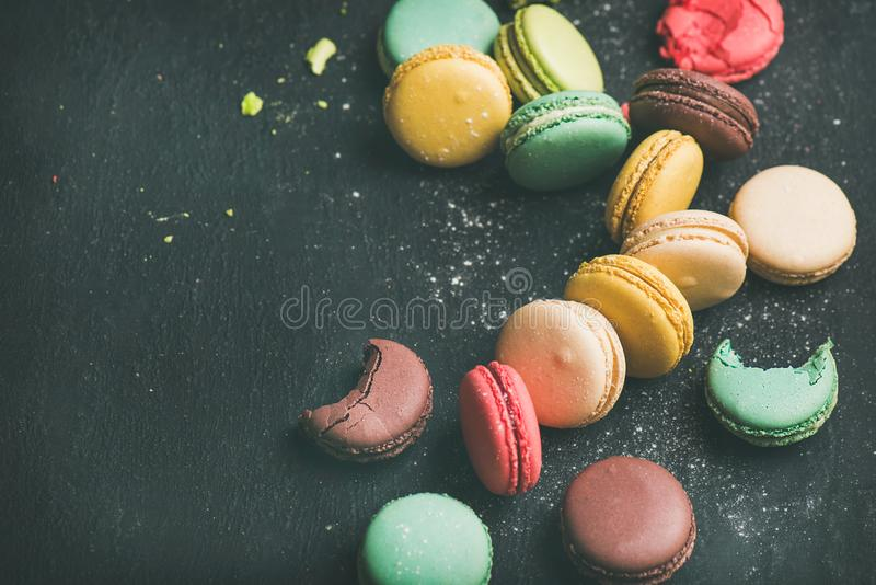 Sweet colorful French macaroon cookies variety with sugar powder royalty free stock photo