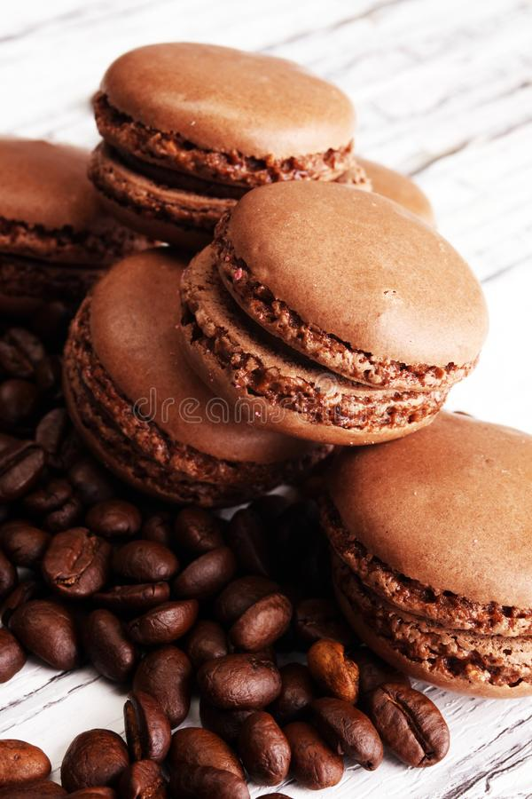 Sweet and colourful french macaroons or macaron with coffee stock image
