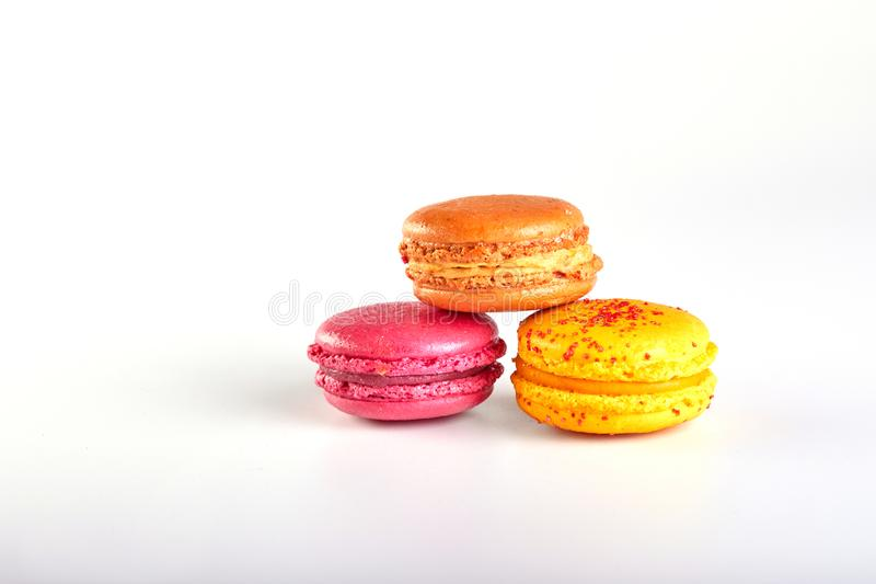 Sweet and colourful french macaroons or macaron on white background royalty free stock photos