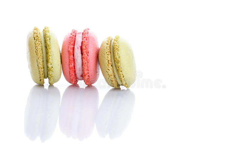 Sweet and colourful french macaroons or macaron on white background stock photography