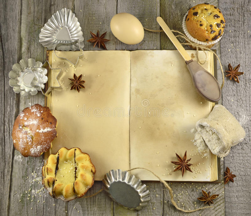 Sweet cook book. Open cook book with sweet things and kitchen ware royalty free stock images
