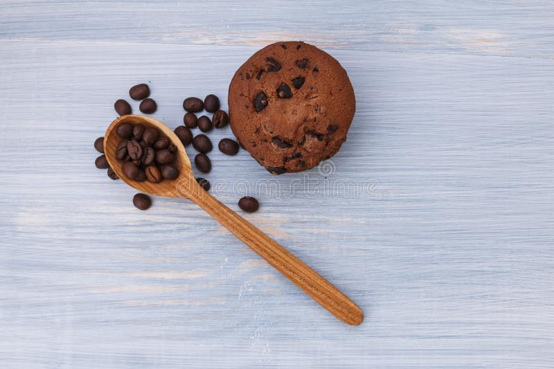 Sweet cookies with chocolate on blue background royalty free stock photo