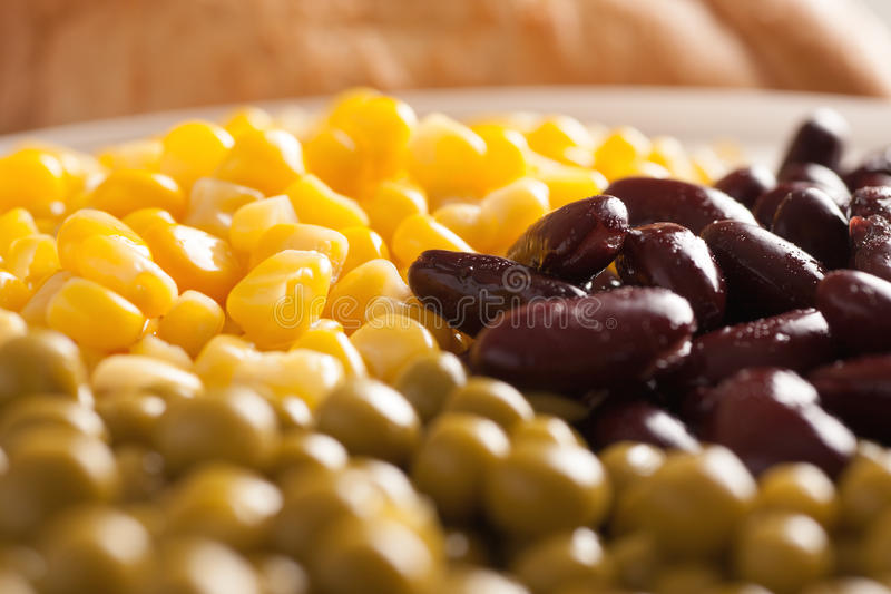 Sweet corn, beans and green peas in a white plate stock photo
