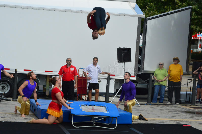 Sweet Corn Festival - Gamma Circus acrobats. Bloomington City, USA - August 27, 2016 - Gamma Phi Circus at Sweetcorn and Blues Festival - This photo was taken stock image