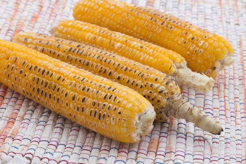 Sweet Corn. Fresh corn on cobs on wooden table, closeup, top view royalty free stock image
