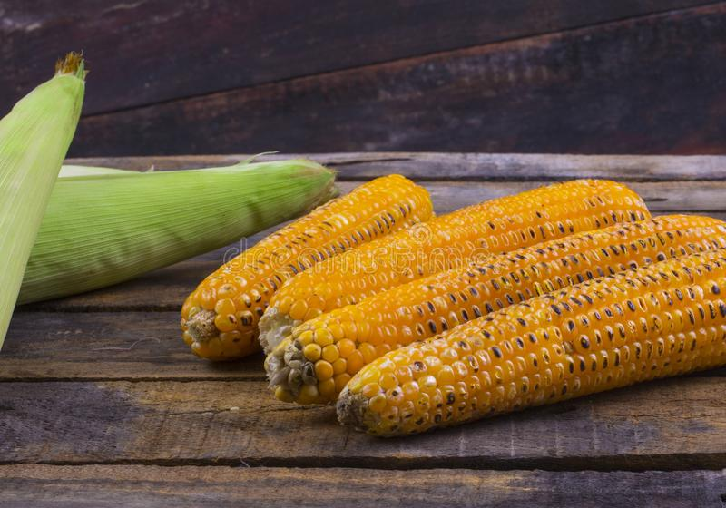 Sweet Corn. Fresh corn on cobs on wooden table, closeup, top view royalty free stock photography