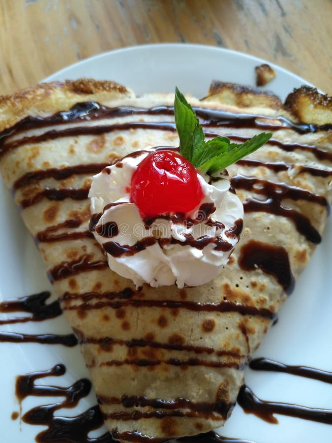 Sweet crepe with cholocate and whipped cream royalty free stock images