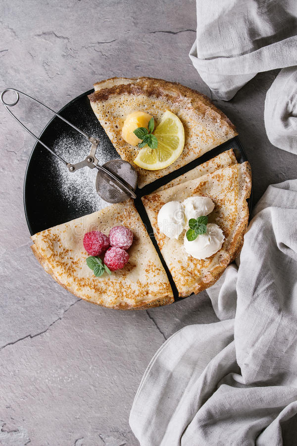 Sweet crepes pancakes with different fillings royalty free stock photos