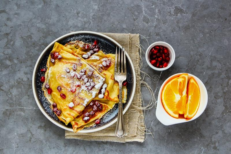 Sweet crepes with pomegranate stock image