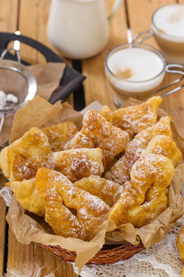 Sweet crisp pastry Angel wings with powdered sugar stock image