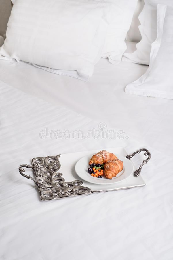 Morning with croissant breakfast with berries on white background royalty free stock images