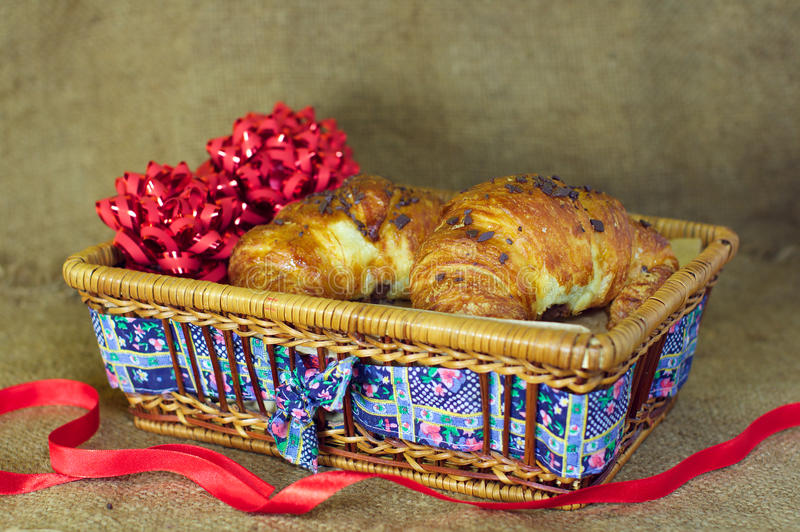 Sweet Croissants with chocolate Christmas present stock photography
