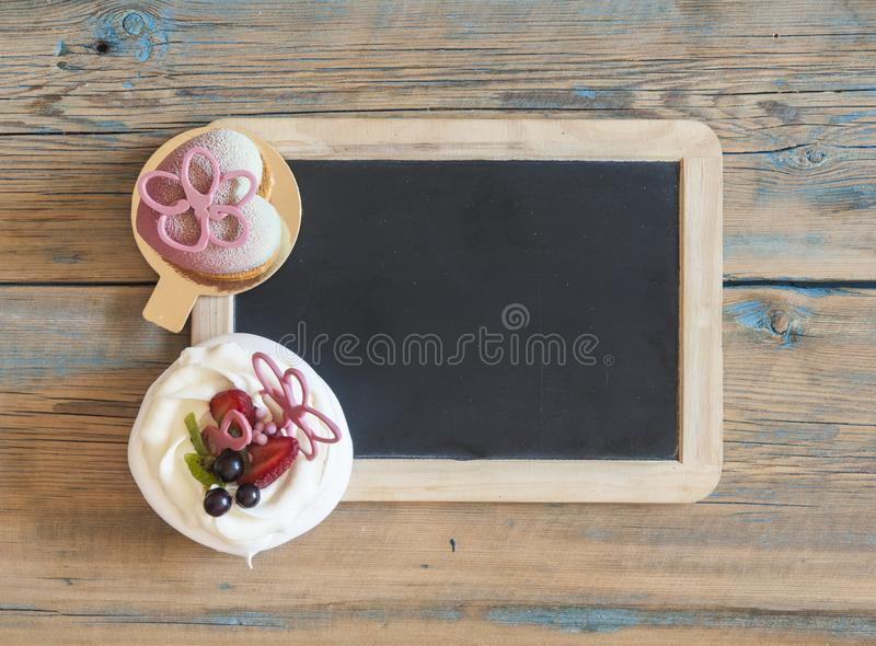 Cupcake on wooden table. stock photos