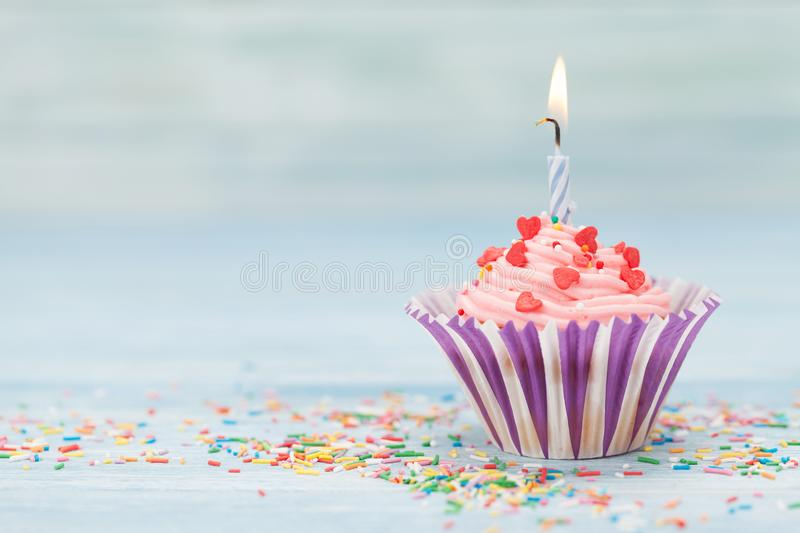 Sweet cupcake with candle stock images