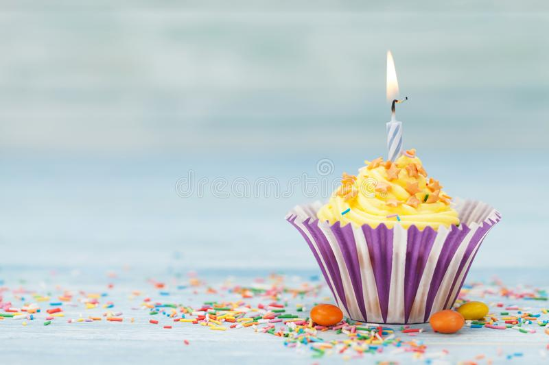 Sweet cupcake with candle stock photo
