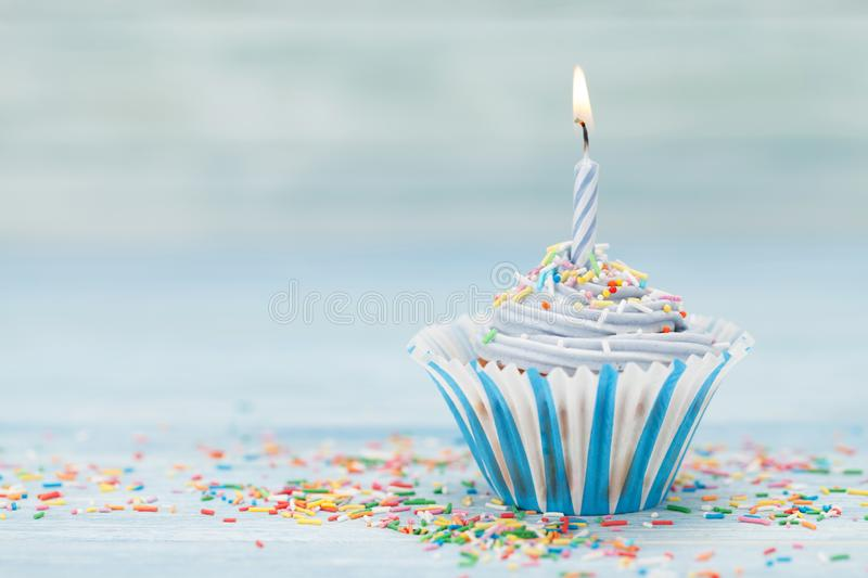 Sweet cupcake with candle royalty free stock image