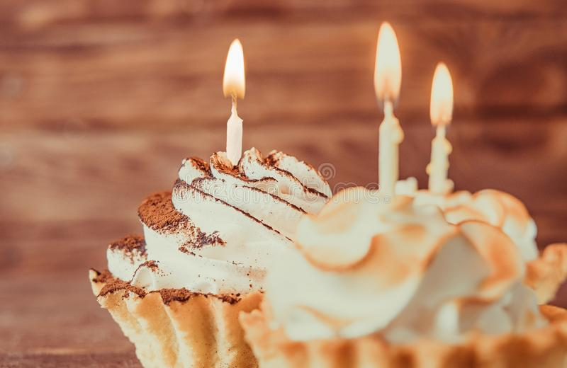 Sweet cupcakes with burning candles. stock image