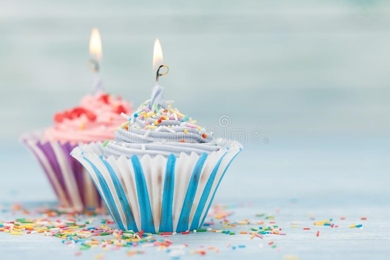 Sweet cupcakes with candles royalty free stock images