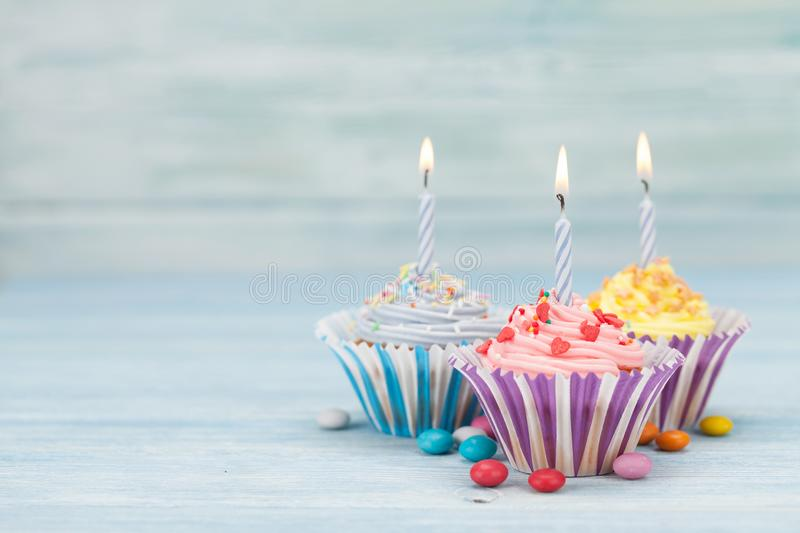Sweet cupcakes with candles royalty free stock photo