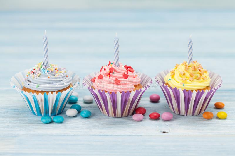 Sweet cupcakes with candles royalty free stock photos