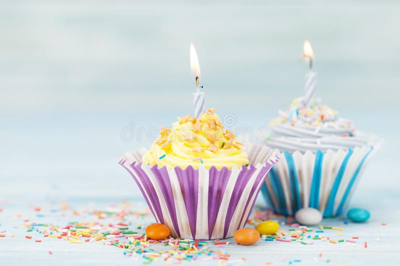 Sweet cupcakes with candles stock photos