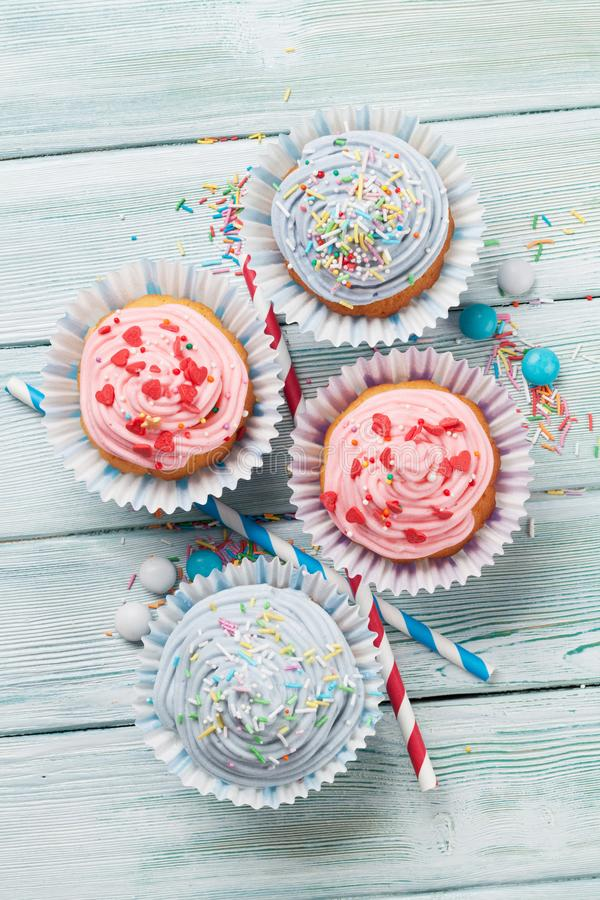 Sweet cupcakes with colorful decor stock photo