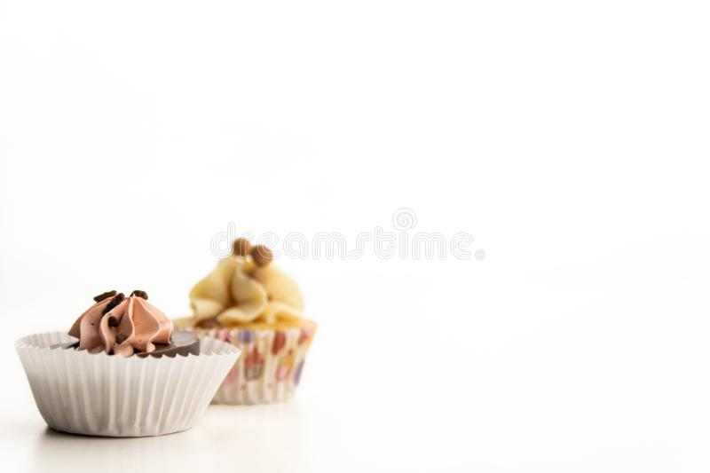 2 sweet cupcakes isolated on white background royalty free stock photos