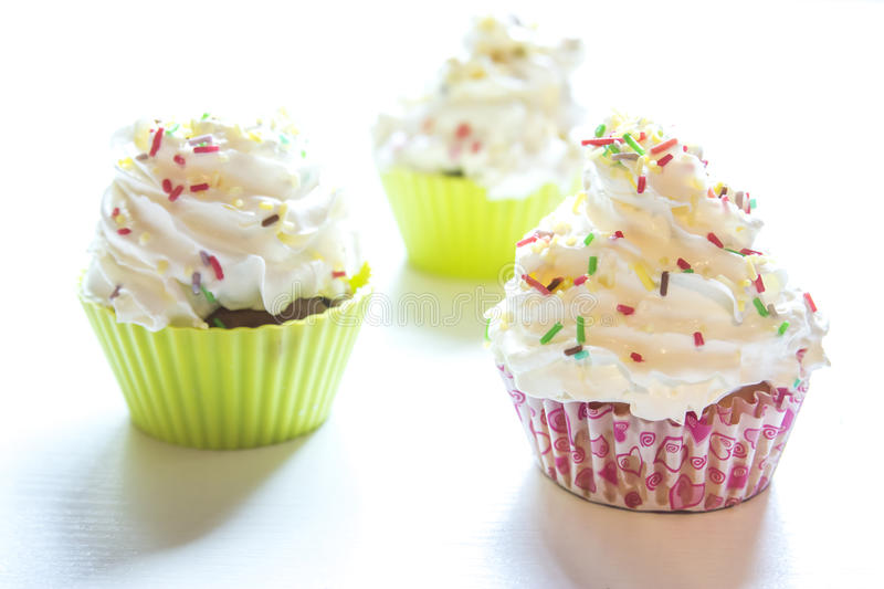 Sweet cupcakes. On a white background stock photo