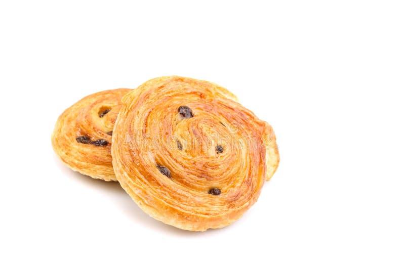 Sweet Danish pastries with custard and raisins isolated on white. Close up sweet Danish pastries with custard and raisins isolated on white background royalty free stock image