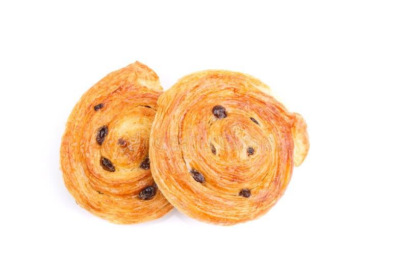 Sweet Danish pastries with custard and raisins isolated on white. Close up sweet Danish pastries with custard and raisins isolated on white background stock photo