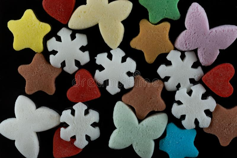 Sweet decoration for confectioners butterflies, hearts, stars, snowflakes stock photo