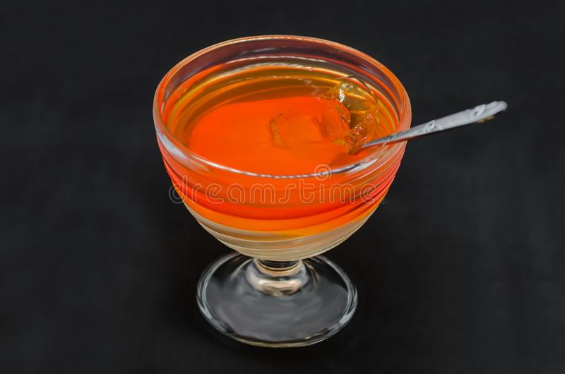 Sweet delicious dessert of multi-colored jelly in a glassware stock images