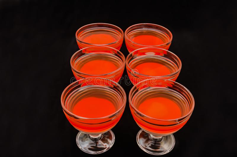 Sweet delicious dessert of multi-colored jelly in a glassware stock photos