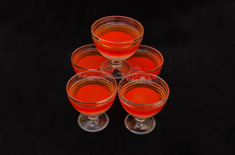 Sweet delicious dessert of multi-colored jelly in a glassware royalty free stock photos