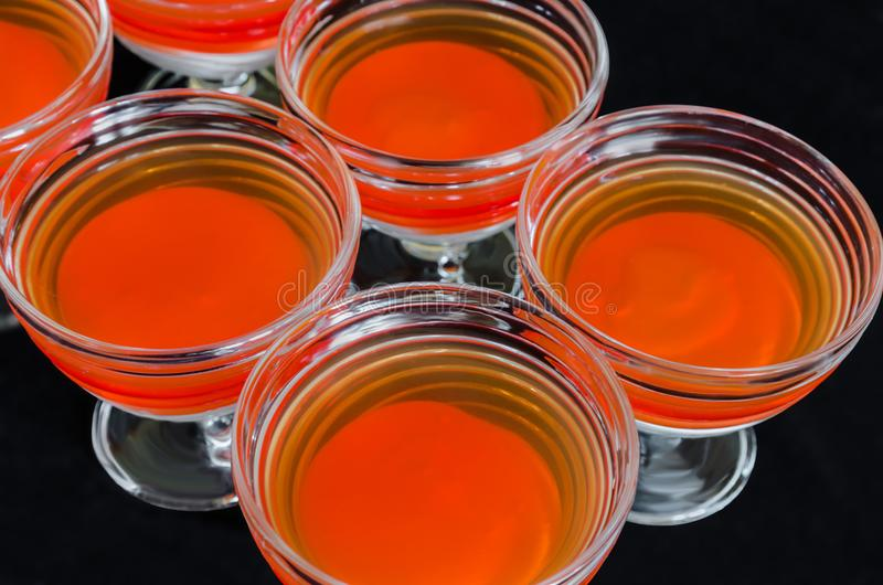 Sweet delicious dessert of multi-colored jelly in a glassware royalty free stock image