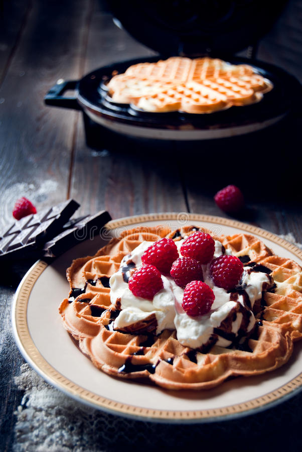 Sweet and delicious waffles with fruits stock photos