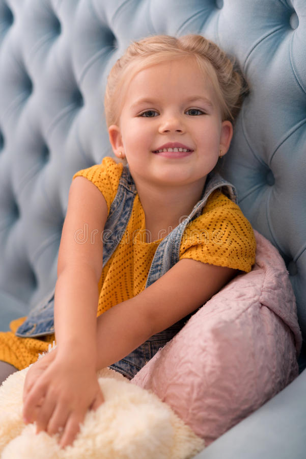 Sweet delighted girl stretching her arms forward stock images