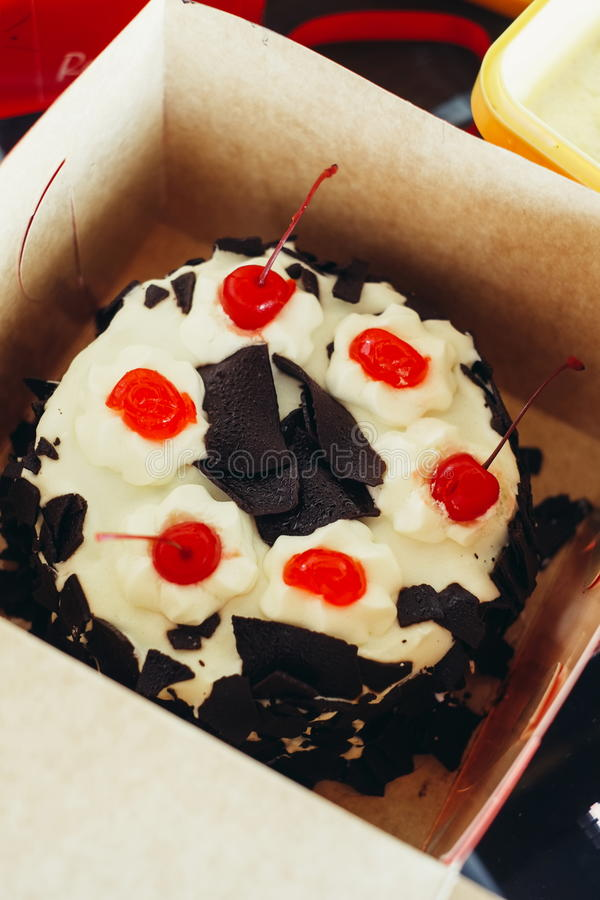 Sweet dessert delicious black forest cake cherry chocolate decoration whip cream cake.  stock images